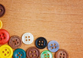 Colorful sewing buttons on a wood background — Foto Stock