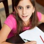 Cute hispanic girl studying at home — Stock Photo