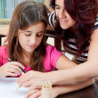 Latin girl studying with her mother — Stock Photo