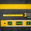 Measuring tools on a black metallic background — Stok fotoğraf