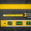 Measuring tools on a black metallic background — Stock Photo
