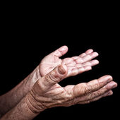 Wrinkled old hands begging — Stock Photo