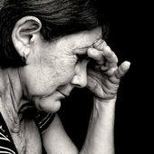 Black and white portrait of a very sad old woman — Stock Photo
