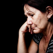 Sad and worried old woman — Stock Photo