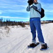 Snowshoeing Photographer — Stock Photo