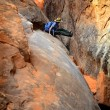 Person Hiking in Slot Canyon - Stock Photo