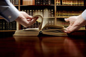 Hand on Book in Library — Stock Photo