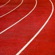 Royalty-Free Stock Photo: Bright Red Running Track