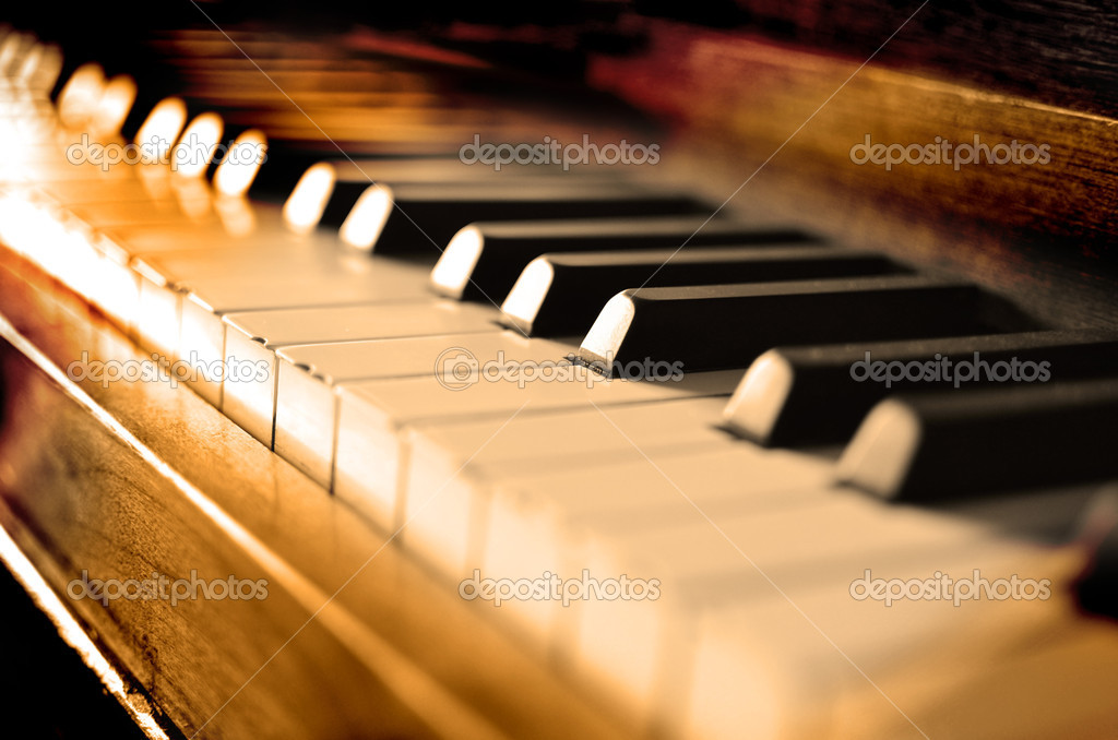 Closeup of antique piano keys and wood grain with sepia tone — Stock Photo #9538113