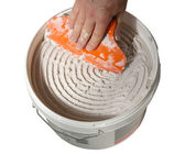 Bucket of tile adhesive — Stock Photo
