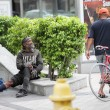 Homeless man asking for help - Stock Photo