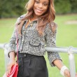 Stock Photo: Young black woman in fashionable clothing