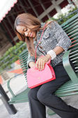 Woman looking through her purse — Stock Photo