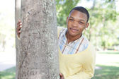 Man posing behind a tree — Stock Photo