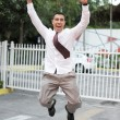 Businessman jumping for joy - 