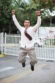 Businessman jumping for joy — Stok fotoğraf
