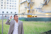 Businessman by an empty land lot — Stock Photo