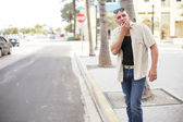 Man whistling for a cab — Stock Photo