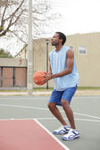 Basketball player about to toss the ball — Stock Photo