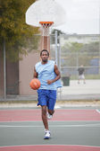 Basketball player running and dribbling the ball — Stock Photo