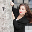 Businesswoman behind a tree — Stock Photo