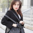 Businesswoman and a handbag — Stock Photo
