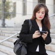 Stock Photo: Woman texting on the phone