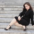 Businesswoman posing on steps — Stock Photo