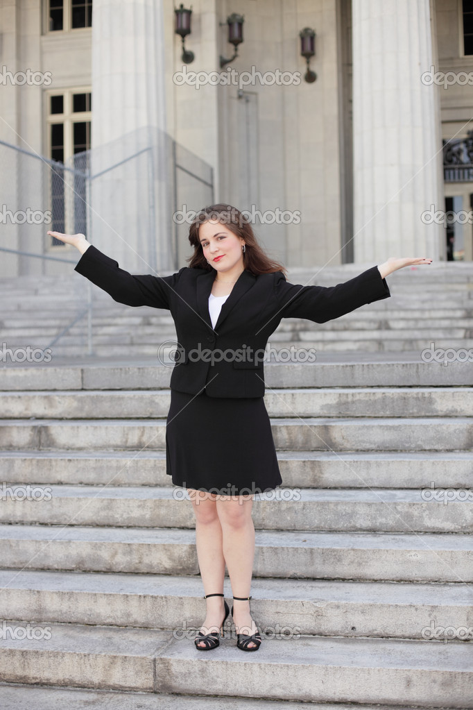 Image of a young businesswoman with arms outstretched  Stock Photo #9817868