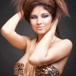 Woman in golden dress playing with her hair — Stock Photo