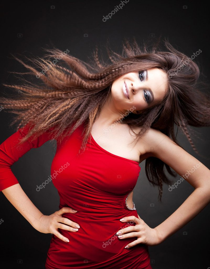 Beautiful woman with long  hair in motion, studio shot — Stock Photo #10185063