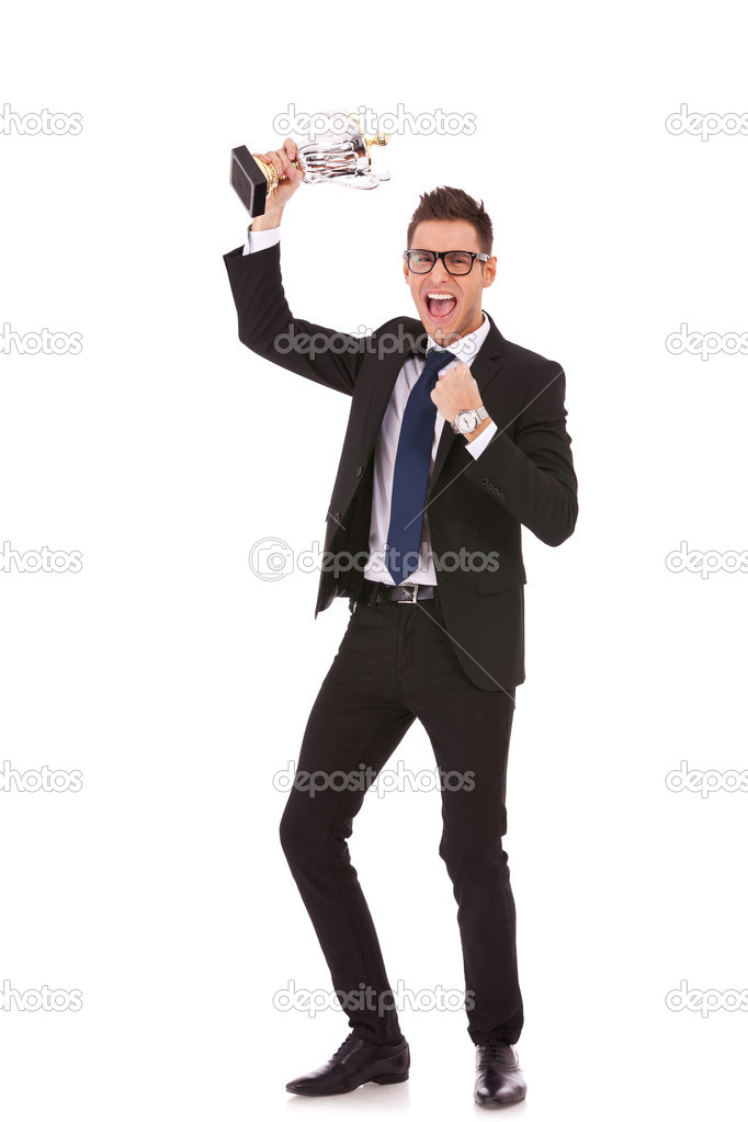 Business man celebrating with trophy on white background — Stock Photo #10188425