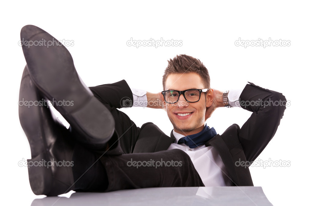 Successful business man relaxing over his desk, isolated in white background — Stock Photo #10188427