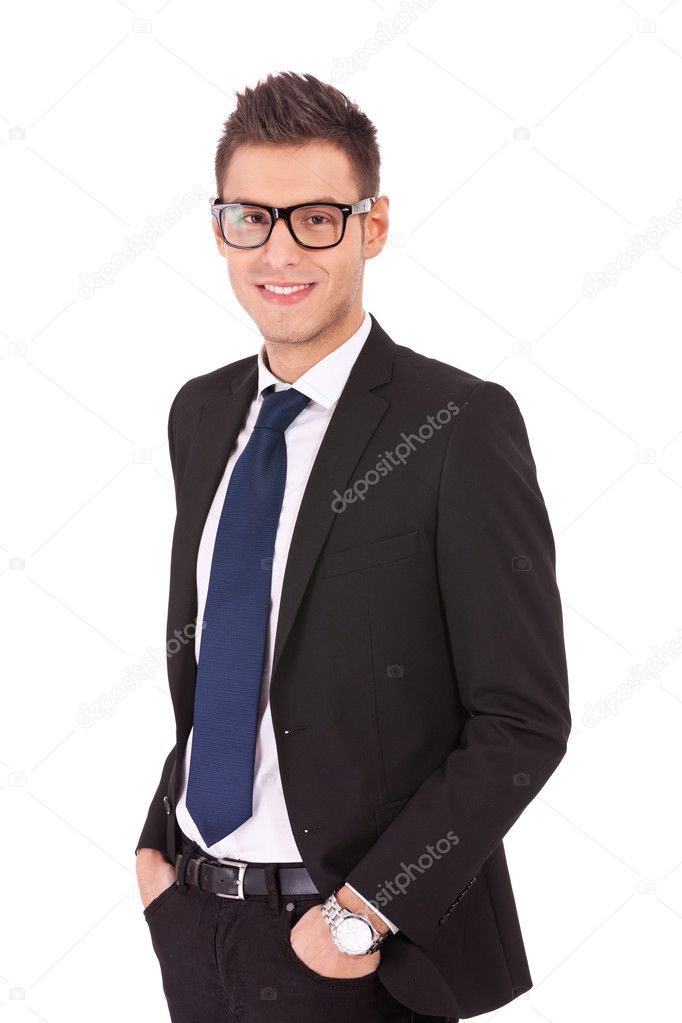 Confident modern business man keeping his hands in trousers pockets isolated on white — Stock Photo #10188440