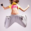 Woman dancer in a jump dance mov — Stock Photo #10576655