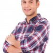 Man casually posing with arms crossed - Stock Photo