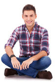 Smiling to the camera while sitting — Stock Photo