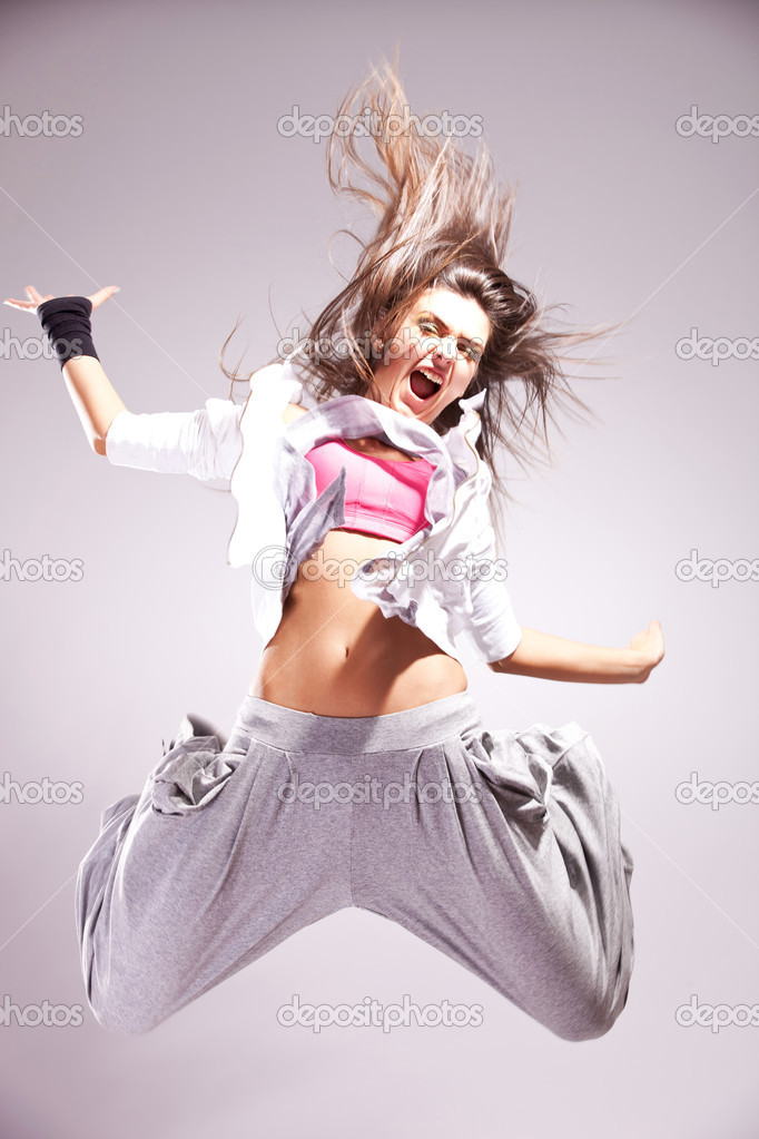 Cool woman dancer jumping in mid air making a nice pose  Stock Photo #10576660