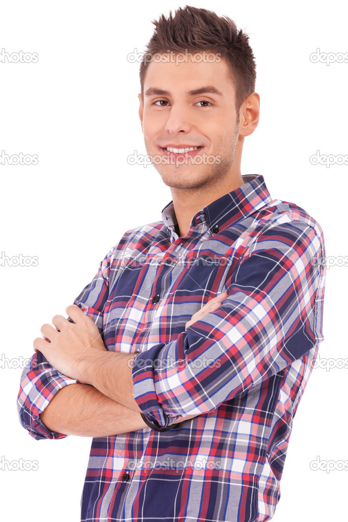 Handsome man casually posing with arms crossed on white background  Stock Photo #10576759
