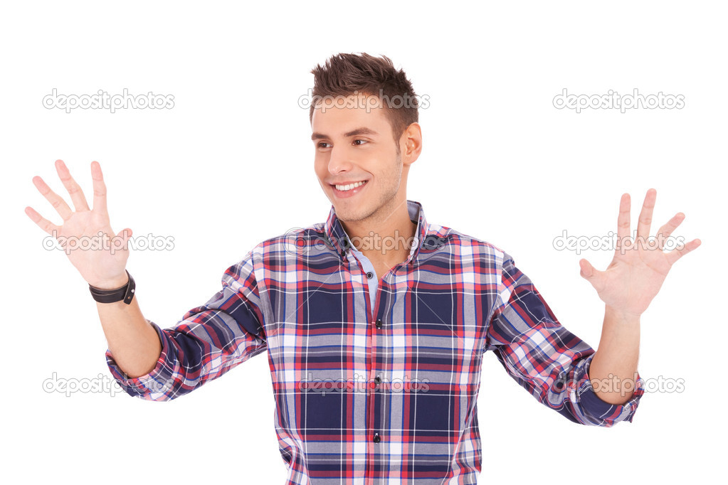 Young casual man pushing with his palms an imaginary keyboard — Stock Photo #10576912