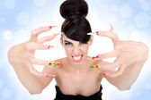 Woman showing her big fancy nails — Stock Photo