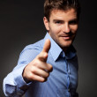 Fashion young man pointing at the camera — Stock Photo