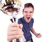 Ecstatic young man winning — Stock Photo