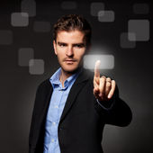Business man pressing a touchscreen button — Stock Photo