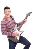 Rock star with an electric guitar — Stock Photo