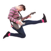 Passionate guitarist jumps in the air — Stock Photo