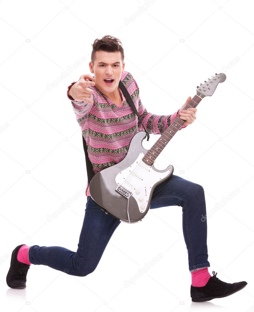 Excited rock star poiting to the camera on white background. rock and roll image of a casual young man poining to the camera and making a choice while playing   — Stock Photo #8990790