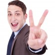 Businessman making the victory hand gesture — Stock Photo #9202239