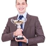 Winning businessman holding his award — Stock Photo