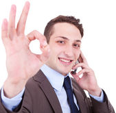 Approving the good news on the phone — Stock Photo